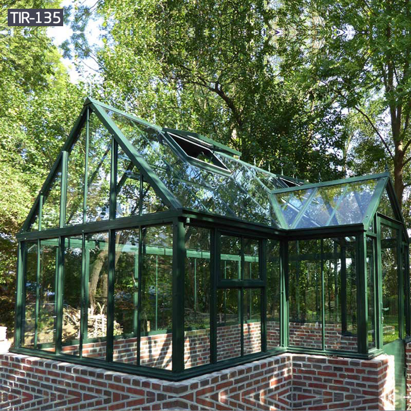 Ornamental wrought iron gazebo with glass designs