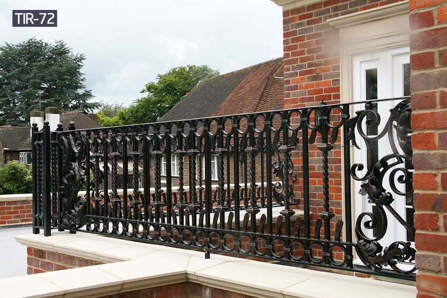 Outdoor yard black wrought iron fence post