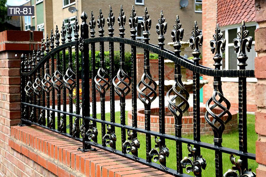 Ornamental black metal yard fence railing outdoor